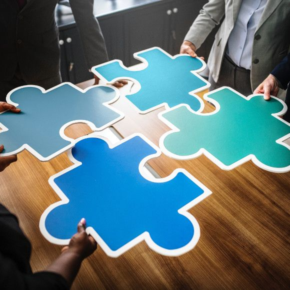 coworkers putting puzzle pieces together